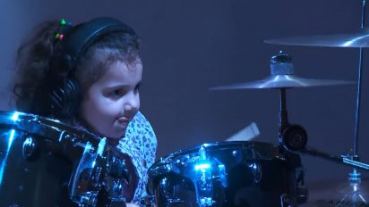 young drummer on stage 1 412x232.jpg - 5-Year-Old Drummer Surprised The Audience With Her Performance On Huge Drum Set