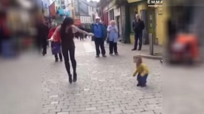 toddler dancing duo 412x232.jpg - Little Toddler Joined Street Performer In Tap Dancing