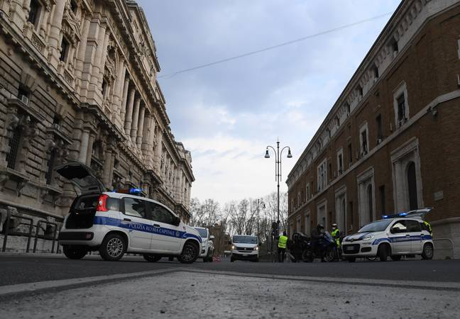 Police are on duty in Italy to make sure residents are abiding with the lock down. Credit: PA